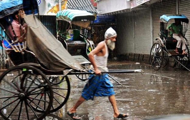 Kolkata in rains, hand-pulled rickshaws in rains