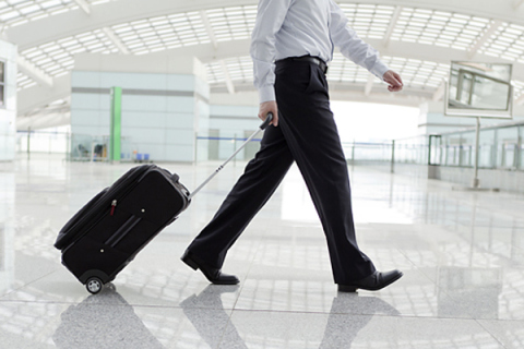 What is US Airways' checked baggage policy for travelers flying to India?