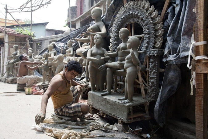 kumortuli artisans Kolkata, Durga idols making, Kolkata tourist attractions, Kumortuli stories
